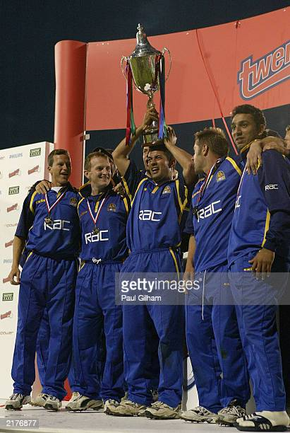 Adam Hollioake of Surrey Lions and his teammates celebrate with the Twenty20 trophy at the end of the Twenty20 Cup final between Surrey and...