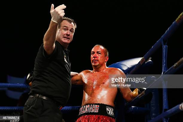 Adam Hollioake reacts after being knocked out by Monty Beethan during Super8 Fight Night at Horncastle Arena on March 28 2015 in Christchurch New...