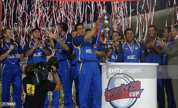 Adam Hollioake, the Surrey captain, and the rest of the team celebrate with the trophy after the Surrey v Warwickshire Final of the Twenty20...