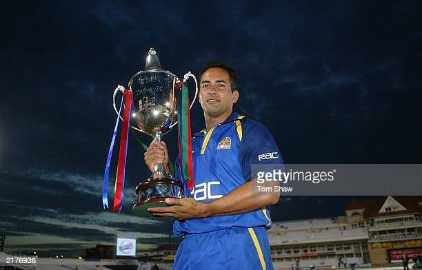 Adam Hollioake, the Surrey captain, celebrates with the trophy after beating Warwickshire in the Surrey v Warwickshire Final of the Twenty20...