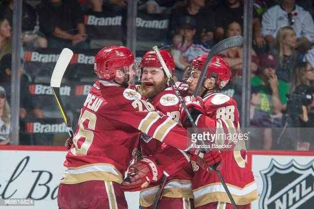 Adam Holwell is congratulated by Olivier Galipeau and Antoine Morand of AcadieBathurst Titan after scoring a goal against the Regina Pats at Brandt...