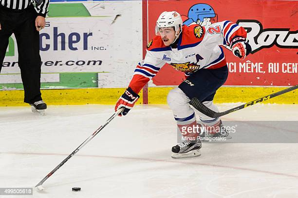 Adam Holwell of the Moncton Wildcats reaches for the puck during the QMJHL game against the Blainville-Boisbriand Armada at the Centre d'Excellence...