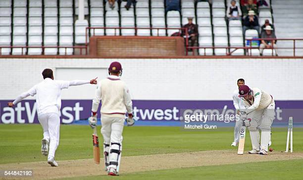Adam Hose of Somerset is bowled out by Mohammad Amir of Pakistan during day two of the tour match between Somerset and Pakistan at The Cooper...