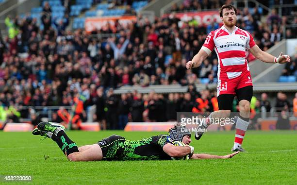 Adam Hughes of Exeter Chiefs goes over for his side's first try during the LV= Cup match between Exeter Chiefs and Gloucester at Sandy Park on...