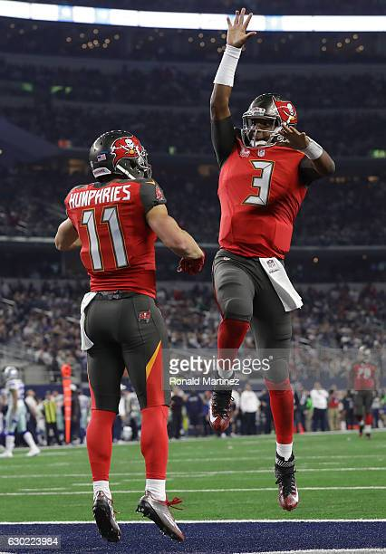 Adam Humphries and Jameis Winston of the Tampa Bay Buccaneers celebrate after a touchdown pass in the third quarter against the Dallas Cowboys at ATT...