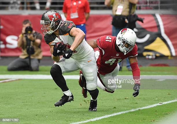 Adam Humphries of the Tampa Bay Buccaneers breaks a tackle by Marcus Cooper of the Arizona Cardinals at University of Phoenix Stadium on September 18...