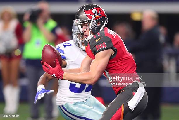 Adam Humphries of the Tampa Bay Buccaneers catches a tipped pass for a touchdown during the third quarter against the Dallas Cowboys at ATT Stadium...
