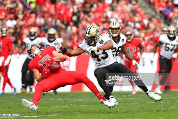 Adam Humphries of the Tampa Bay Buccaneers drops a pass defended by Marcus Williams of the New Orleans Saints during the first quarter at Raymond...