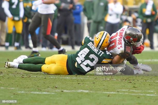 Adam Humphries of the Tampa Bay Buccaneers is brought down by Morgan Burnett of the Green Bay Packers during the second half at Lambeau Field on...