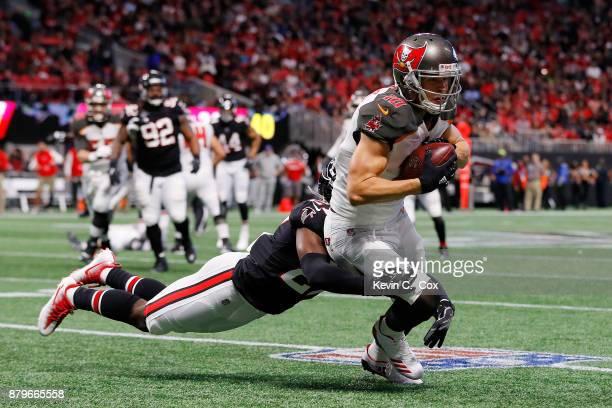Adam Humphries of the Tampa Bay Buccaneers is tackled after a catch by Damontae Kazee of the Atlanta Falcons during the second half at MercedesBenz...