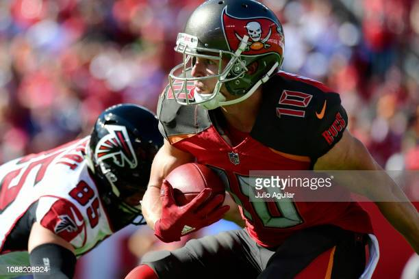 Adam Humphries of the Tampa Bay Buccaneers looks for a path after receiving a punt during the second quarter against the Atlanta Falcons at Raymond...
