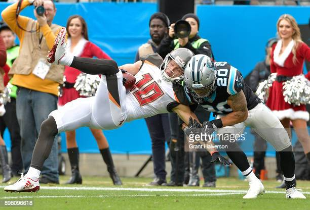 Adam Humphries of the Tampa Bay Buccaneers makes a catch against Kurt Coleman of the Carolina Panthers during their game at Bank of America Stadium...