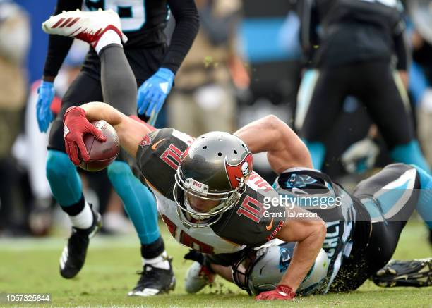 Adam Humphries of the Tampa Bay Buccaneers reaches across the goal line for a touchdown as Luke Kuechly of the Carolina Panthers defends during the...