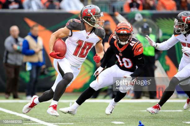 Adam Humphries of the Tampa Bay Buccaneers runs the ball past Brandon Wilson of the Cincinnati Bengals during the first quarter at Paul Brown Stadium...
