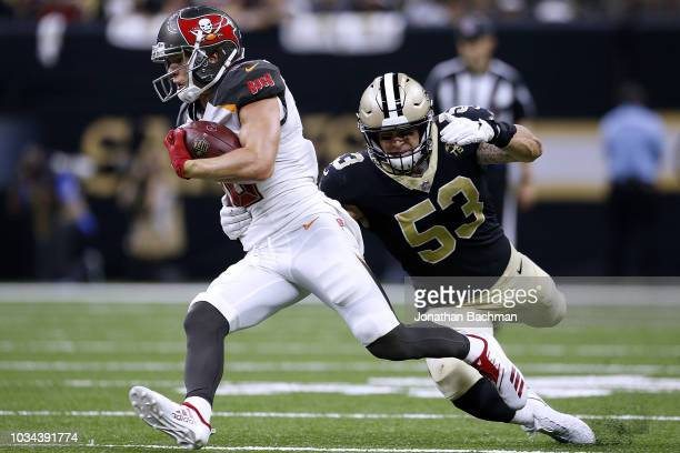 Adam Humphries of the Tampa Bay Buccaneers runs with the ball as AJ Klein of the New Orleans Saints defends during a game at the MercedesBenz...