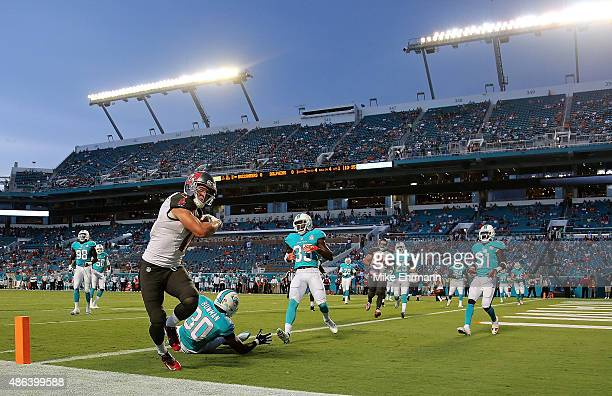 Adam Humphries of the Tampa Bay Buccaneers scores a touchdown during a preseason game against the Miami Dolphins at Sun Life Stadium on September 3...