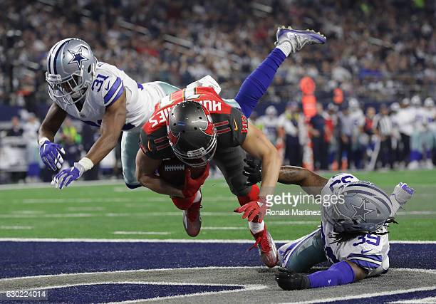 Adam Humphries of the Tampa Bay Buccaneers scores a touchdown on a deflected pass from Jameis Winston during the third quarter against the Dallas...