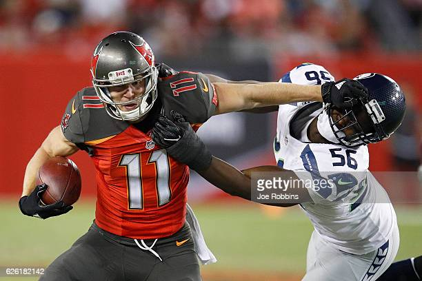 Adam Humphries of the Tampa Bay Buccaneers tries to break away from Cliff Avril of the Seattle Seahawks in the fourth quarter of the game at Raymond...