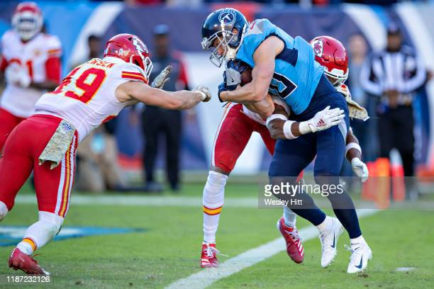 Adam Humphries of the Tennessee Titans runs the ball for a touchdown and is met at the goal line by Juan Thornhill of the Kansas City Chiefs at...