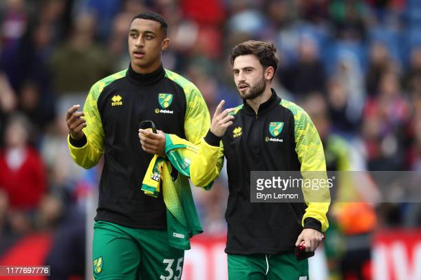 Adam Idah and Patrick Roberts of Norwich City look on ahead of the Premier League match between Crystal Palace and Norwich City at Selhurst Park on...