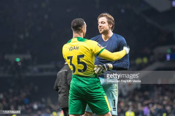 Adam Idah and Tim Krul of Norwich City reacts after winning penalty shootout during the FA Cup Fifth Round match between Tottenham Hotspur and...