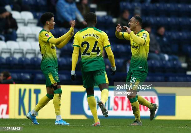 Adam Idah of Norwich celebrates with Ibrahim Amadou and Jamal Lewis after scoring his team's second goal during the FA Cup Third Round match between...