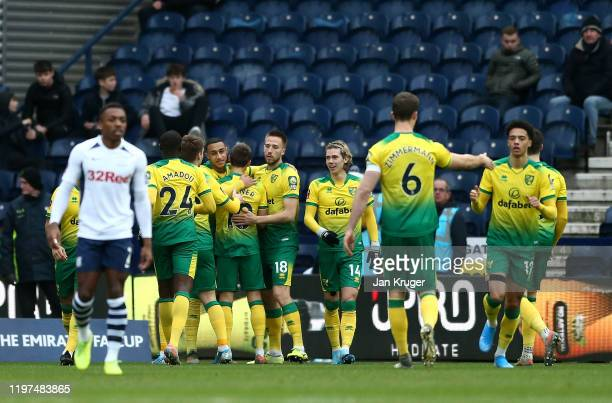 Adam Idah of Norwich celebrates with teammates after scoring his team's first goal during the FA Cup Third Round match between Preston North End and...