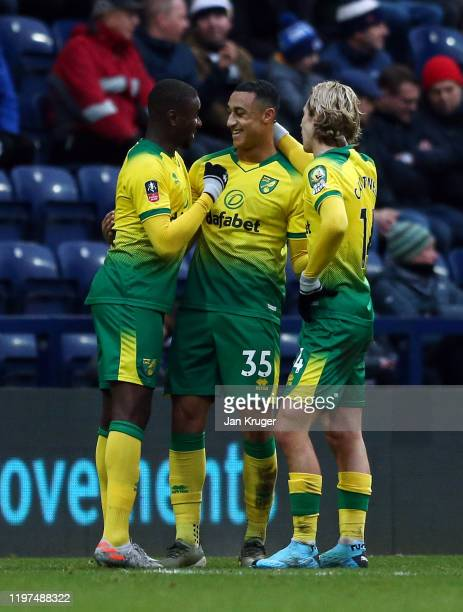 Adam Idah of Norwich celebrates with Todd Cantwell after scoring his team's second goal during the FA Cup Third Round match between Preston North End...