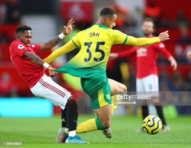 Adam Idah of Norwich City is fouled by Fred of Manchester United during the Premier League match between Manchester United and Norwich City at Old...