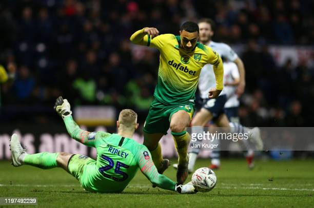 Adam Idah of Norwich is tackled by Connor Ripley of Preston North End during the FA Cup Third Round match between Preston North End and Norwich City...