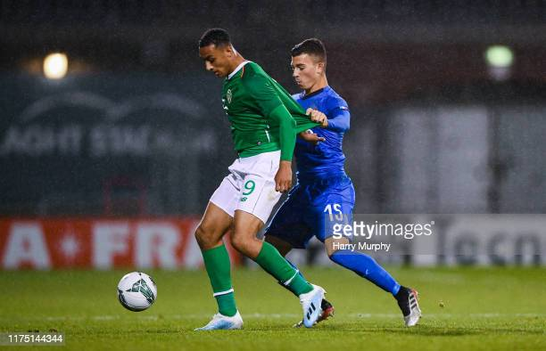 Adam Idah of Republic of Ireland in action against Enrico Del Prato of Italy during the UEFA U21 Championships Qualifier match between the Republic...