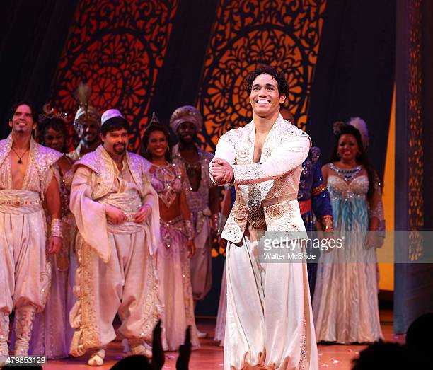 Adam Jacobs and cast during the Broadway Opening Night Performance Curtain Call for Disney's 'Aladdin' at the New Amsterdam Theatre on March 20 2014...