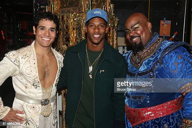 Adam Jacobs as 'Aladdin' NY Giants Victor Cruz and James Monroe Iglehart as 'The Genie' pose backstage at 'Disney's Aladdin' on Broadway at The New...