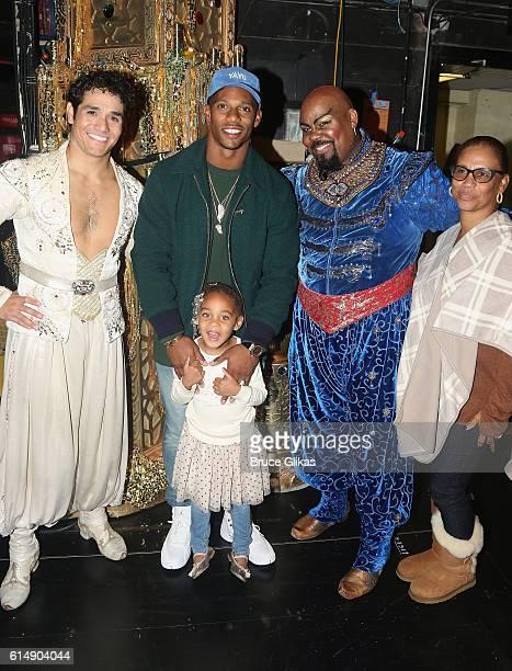 Adam Jacobs as Aladdin NY Giants Victor Cruz daughter Kennedy Cruz James Monroe Iglehart as The Genie and grandmother Blanca Cruz pose backstage at...