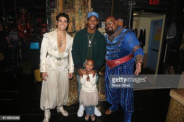 Adam Jacobs as 'Aladdin' NY Giants Victor Cruz daughter Kennedy Cruz and James Monroe Iglehart as 'The Genie' pose backstage at 'Disney's Aladdin' on...