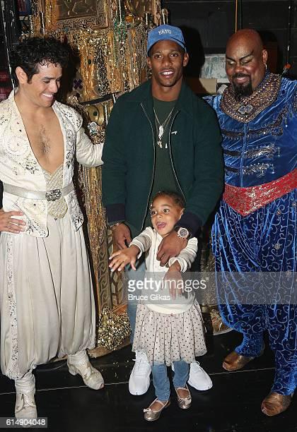 Adam Jacobs as Aladdin NY Giants Victor Cruz daughter Kennedy Cruz and James Monroe Iglehart as The Genie pose backstage at Disney's Aladdin on...