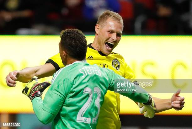 Adam Jahn of Columbus Crew reacts with goalkeeper Zack Steffen after converting a penalty kick to give the Crew a win over the Atlanta United 31 on...