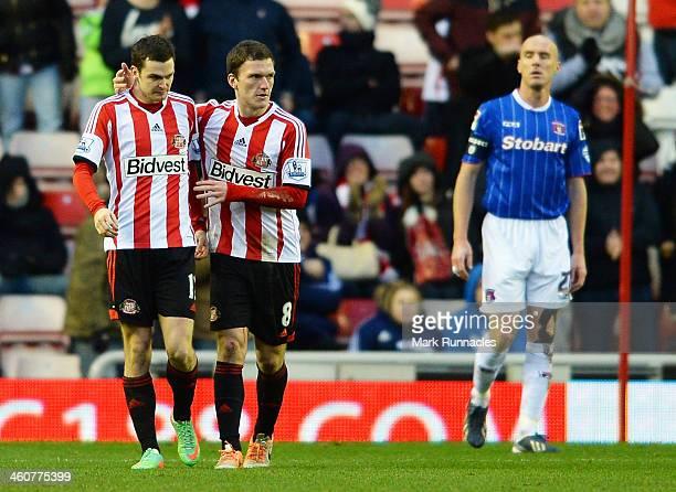 Adam Johnson and Craig Gardner of Sunderland celebrate after Sean O'Hanlon of Carlisle scores an own goal during the Budweiser FA Cup third round...