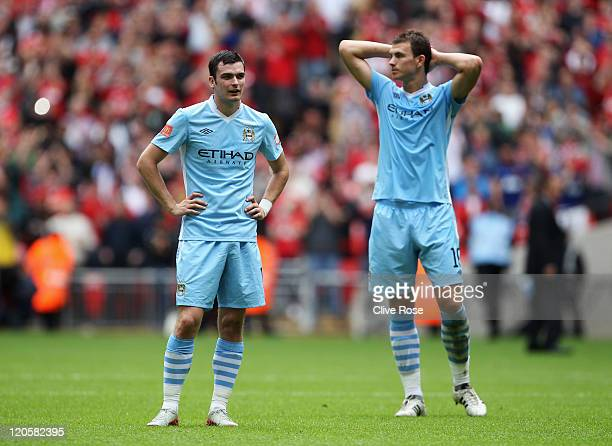 Adam Johnson and Edin Dzeko of Manchester City looks dejected after defeat in the FA Community Shield match sponsored by McDonald's between...