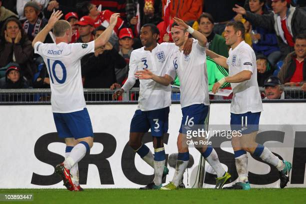 Adam Johnson of England celebrates his goal during the UEFA EURO 2012 Group G Qualifier between Switzerland and England at St Jakob Park on September...