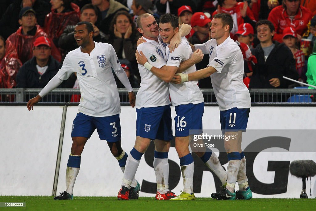 Adam Johnson of England celebrates his goal with Wayne Rooney during the UEFA EURO 2012 Group G Qualifier between Switzerland and England at St Jakob Park on September 7, 2010 in Basel, Switzerland.