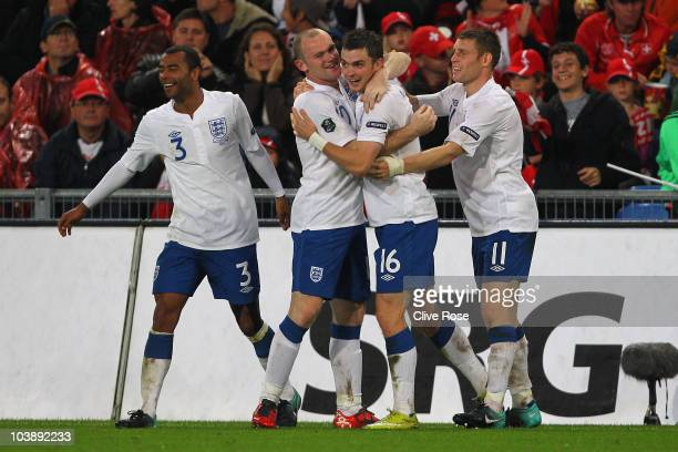 Adam Johnson of England celebrates his goal with Wayne Rooney during the UEFA EURO 2012 Group G Qualifier between Switzerland and England at St Jakob...