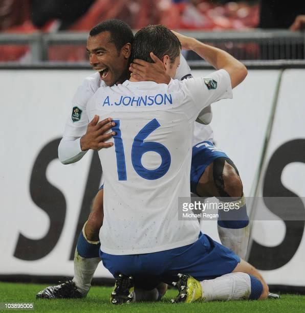 Adam Johnson of England celebrates scoring with Ashley Cole during the UEFA EURO 2012 Group G Qualifier between Switzerland and England at St Jakob...