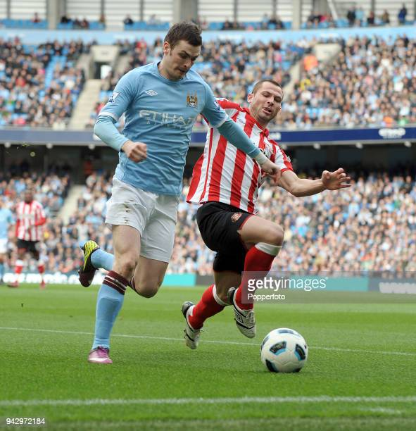 Adam Johnson of Manchester City and Phil Bardsley of Sunderland in action during the Barclays Premier League match between Manchester City and...