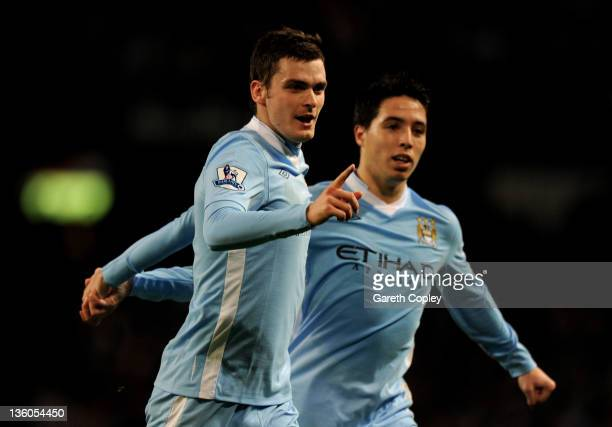 Adam Johnson of Manchester City celebrates scoring his team's second goal during the Barclays Premier League match between Manchester City and Stoke...