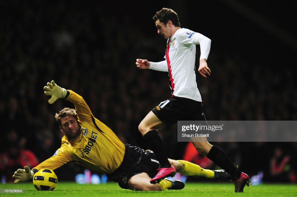 Adam Johnson of Manchester City rounds Robert Green the West Ham United goalkeeper to score his sides third goal during the Barclays Premier League match between West Ham United and Manchester City at Upton Park on December 11, 2010 in London, England.