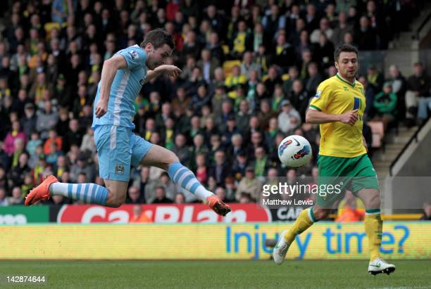 Adam Johnson of Manchester City scores his team's sixth goal during the Barclays Premier League match between Norwich City and Manchester City at...