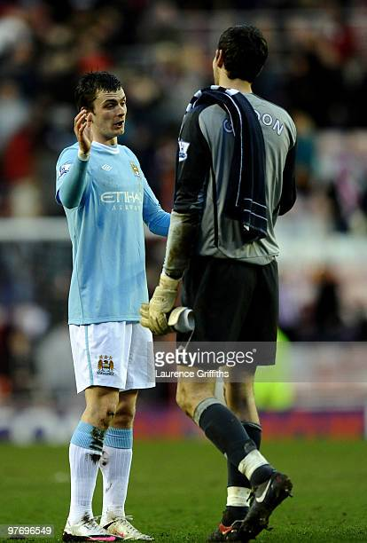 Adam Johnson of Manchester City shakes hands with Craig Gordon of Sunderland at the end of the Barclays Premier League match between Sunderland and...