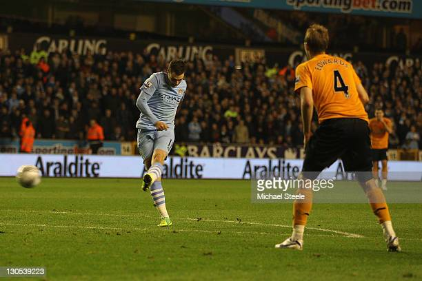 Adam Johnson of Manchester scores his sides first goal during the Carling Cup Fourth Round match at Molineux on October 26 2011 in Wolverhampton...