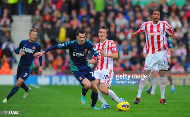 Adam Johnson of Sunderland battles Dean Whitehead of Stoke during the Barclays Premier League match between Stoke City and Sunderland at the...